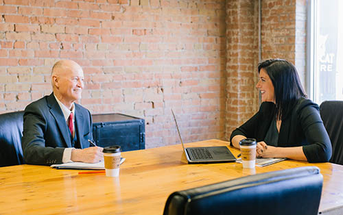 photo of two people in a conference room